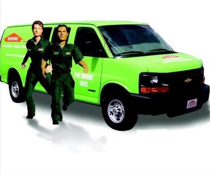 SERVPRO van in the background and two cartoon like men running to the customers rescue
